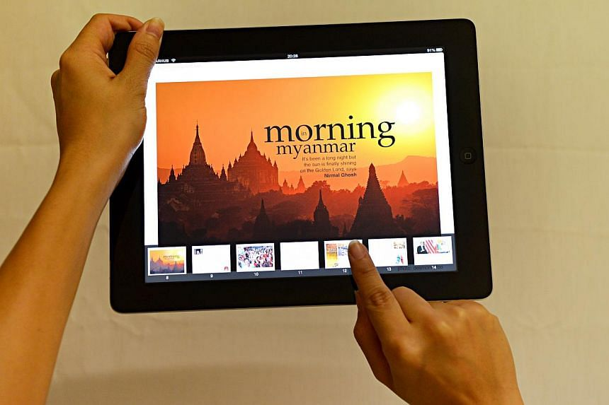"An iPad displaying Myanmar Sunrise, the first interactive e-book launched by The Straits Times. The e-book was the winner in the ""Specialty/Niche Sites and Niche Apps"" category at this year's Pacific Area Newspaper Publishers' Association ("