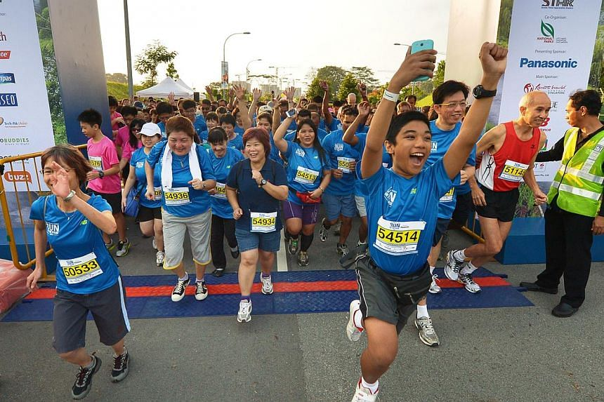 """Runners burst through the start line at theinaugural ST Run at Punggol Waterwayon Aug 25, 2013. TheStraits Times Appreciates Readers (Star) programmewon the best """"Newspaper Event"""" award for newspapers of 90,000 and above in ci"""