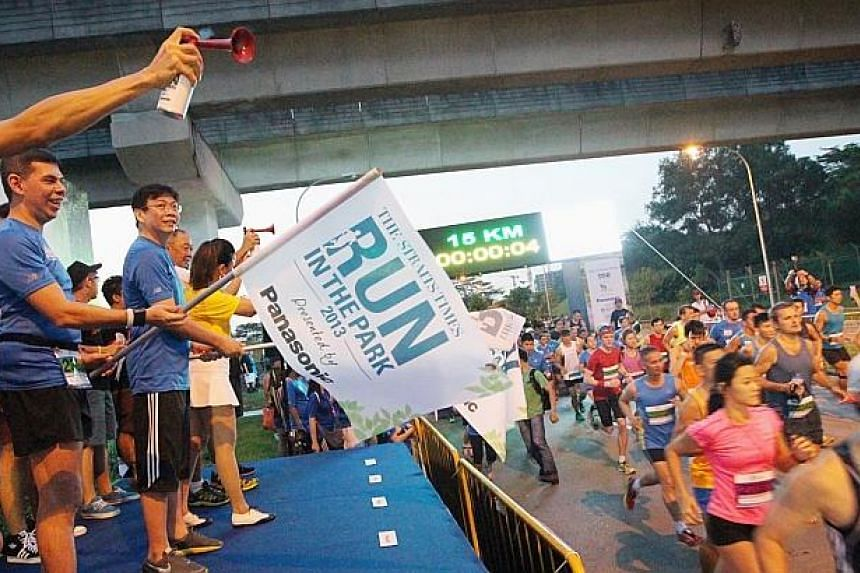 "The Straits Times Editor Warren Fernandez (second from left) flags off participants at the inaugural ST Run at Punggol Waterway on Aug 25, 2013. The Straits Times Appreciates Readers (Star) programme won the best ""Newspaper E"