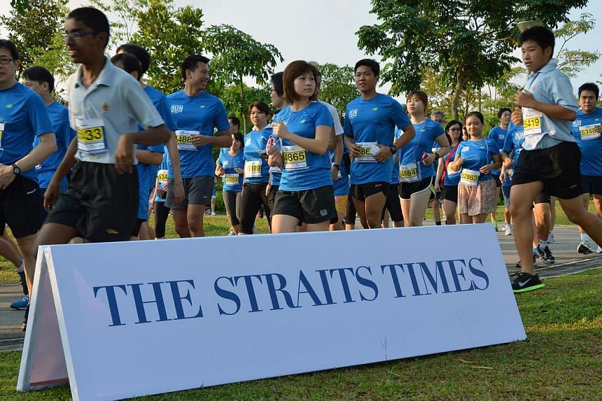 """Runners at theinaugural ST Run at Punggol Waterway. TheStraits Times Appreciates Readers (Star) programmewon the best """"Newspaper Event"""" award for newspapers of 90,000 and above in circulationat this year's Pacific Area Newspap"""