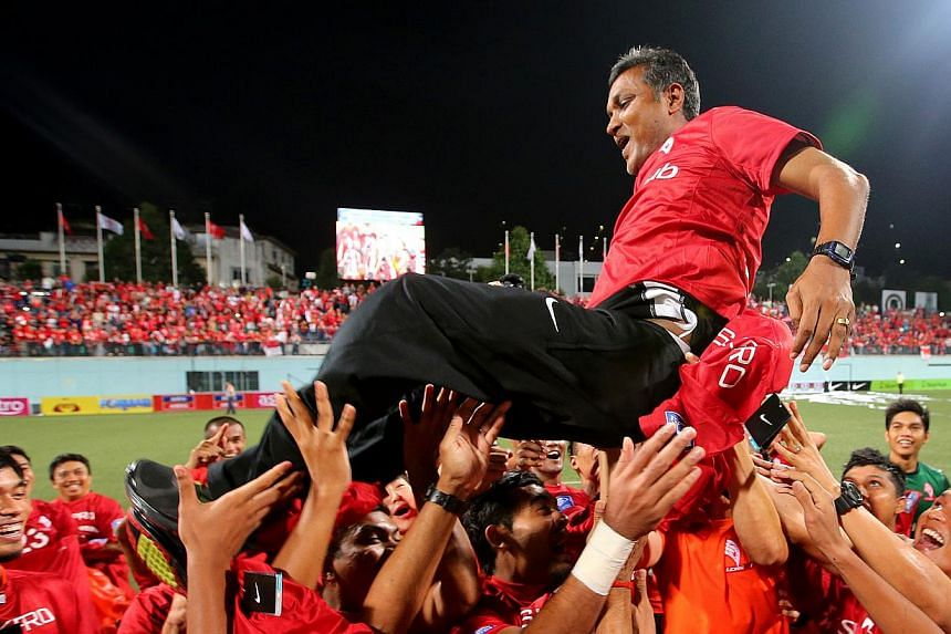 JULY 2: LionsXII coach V. Sundramoorthy is thrown in the air by his players after they beat Felda United 4-0 to clinch the Malaysian Super League title at the Jalan Besar Stadium. But it all went downhill from there for the Singapore side - they are