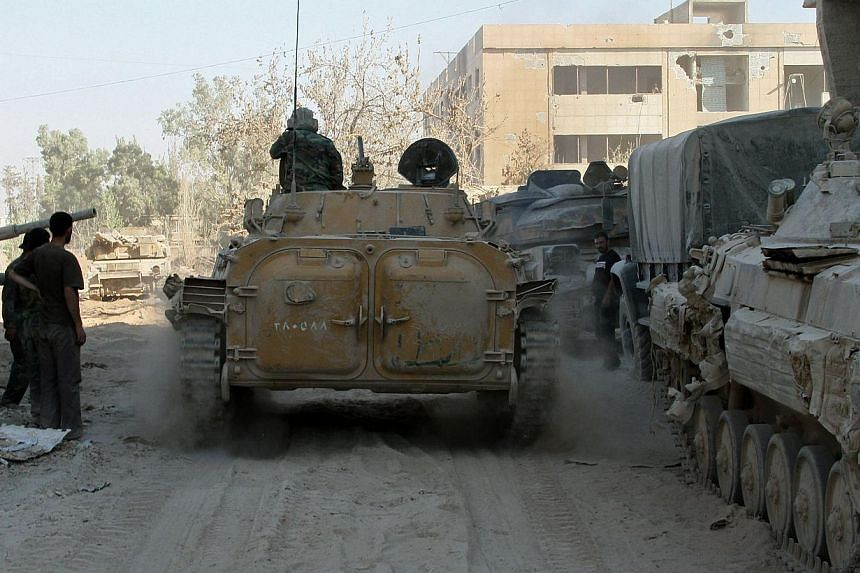 Syrian army soldiers are seen deployed in the Jobar neighbourhood of Damascus on Saturday, Aug 24, 2013.The five permanent members of the UN Security Council failed to reach an agreement on Wednesday, Aug 28, 2013, on a British-proposed resolut