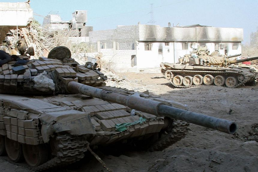 Syrian army tanks are seen deployed in the Jobar neighbourhood of Damascus on Saturday, Aug 24, 2013. Chinese state media warned the West against strikes on Syria on Thursday, Aug 29, 2013, as momentum mounted for President Bashar al-Assad's reg