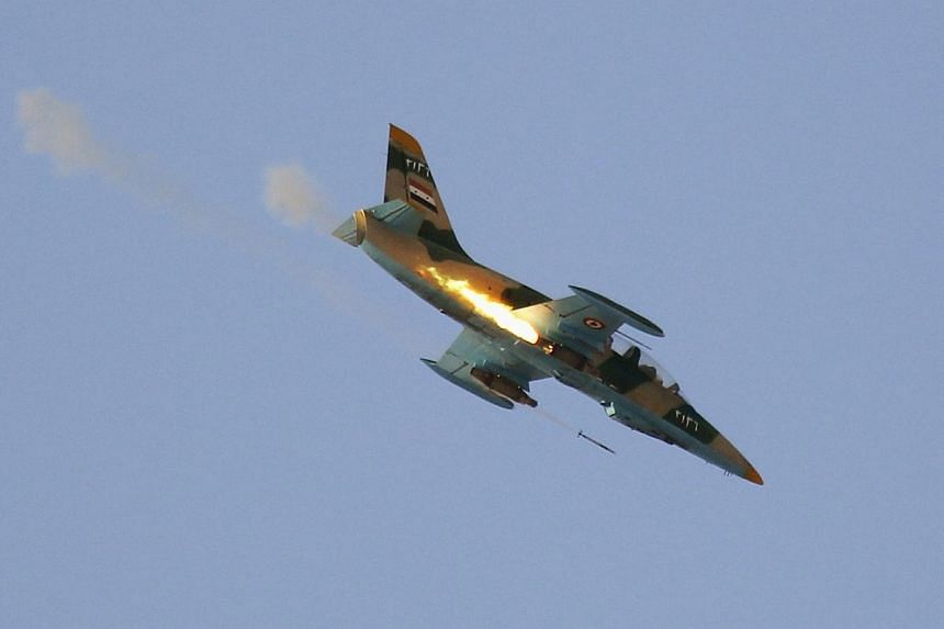 A Syrian Air Force fighter plane fires a rocket during an air strike in the village of Tel Rafat, some 37km north of Aleppo on Aug 9, 2012.Syrian Prime Minister Wael al-Halqi called on Thursday for mobilising national resources to preserve esse