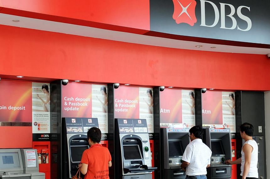 Customers withdrawing money at DBS machines in Tampines Central. A campaign to raise public awareness about the benefits of debit and credit cards with embedded chips will be launched by DBS and POSB Bank next month.-- ST FILE PHOTO:AZIZ