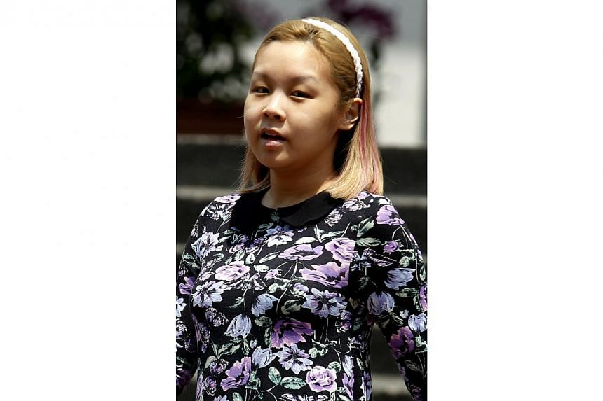 Liew Shu Hui Crystal, 23, was sentenced to one week in jail for causing hurt to Rod In Yuvana, by using a decanter to hit her near her temple region causing her to suffer bodily pain at the Neverland Thai Disco. -- ST PHOTO: WONG KWAI CHOW