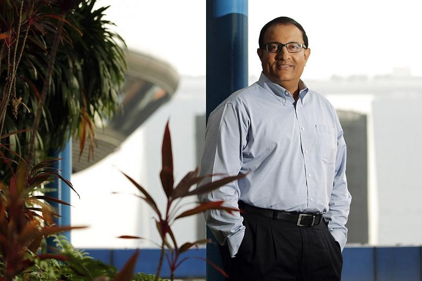 A strong core of Singaporean talent is needed to help drive local companies' expansion plans abroad said Second Minister for Trade and Industry, Mr S Iswaran (above) in a speech at an IE Singapore scholarship ceremony on Thursday. -- ST FILE PHOTO: L