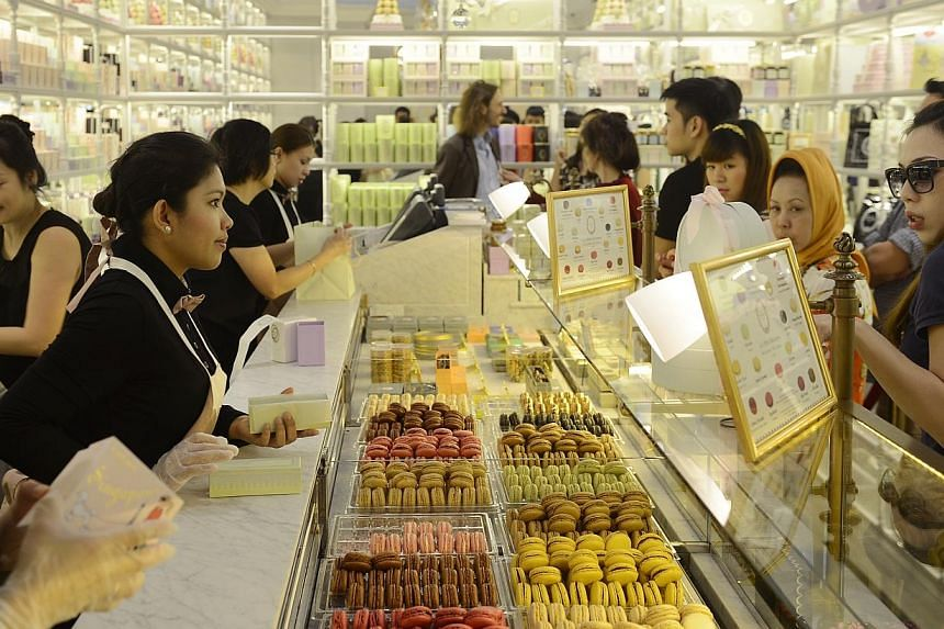 People at French parisian patisserie Laduree's store at Ngee Ann City.Six of Singapore's retailers were honoured at the Singapore Retailers Association (SRA) Ball 2013 on Thursday night, including Parisian patisserie Laduree which won Best New