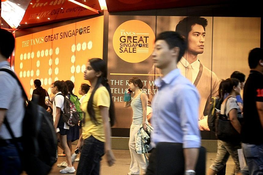 Local shoppers splashed out more at this year's Great Singapore Sale (GSS), making it more lucrative than the last one. But visitors' spending took a tumble, according to MasterCard. -- ST FILE PHOTO: KEVIN LIM