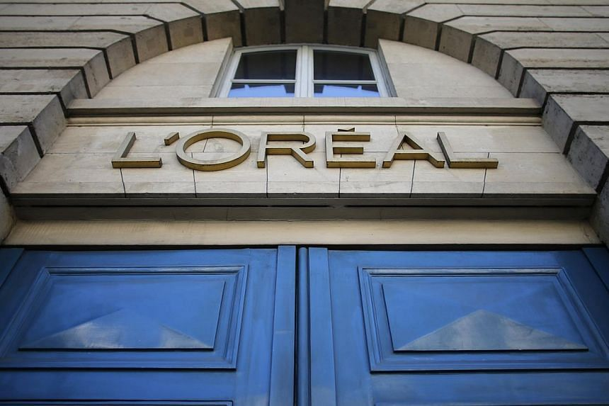 A logo is seen over the entrance of Cosmetics company L'Oreal building in Paris, on Aug 16, 2013. L'Oreal will be ready to buy Nestle's 29.5 per cent stake in the French cosmetics giant next year, French daily Les Echos reported, citing L'Oreal chief