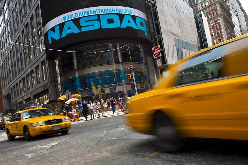 Taxi cabs drive past the Nasdaq MarketSite in New York's Times Square, on Aug 23, 2013. Nasdaq OMX Group's massive trading halt last week was due to a software bug and other internal technology issues triggered by problems at NYSE Euronext's Arca exc