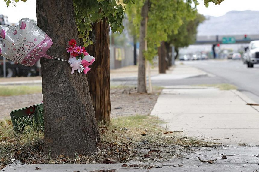 A makeshift memorial on a tree is shown, on Thursday, Aug 29, 2013, in Phoenix. A six-year-old Phoenix girl received fatal injuries when her eight-year-old brother crashed the family car into a metal pole during a late-night drive in their pajamas, p