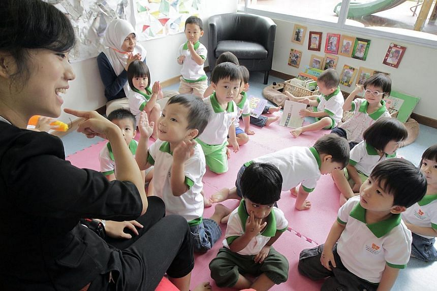 A teacher leading a group of toddlers in a music and movement class at pre-school The Caterpillar's Cove on April 18, 2011. Acting Minister for Social and Family Development Chan Chun Sing outlined the Government's plan to enhance scholarships and