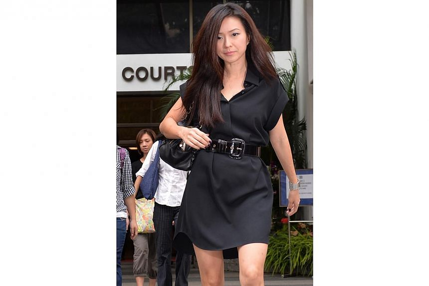 Ms Serina Wee, former finance manager of City Harvest Church (CHC), returns to court on Aug 26, 2013, in a simple black dress with a thick belt. -- ST PHOTO: MUGILAN RAJASEGERAN