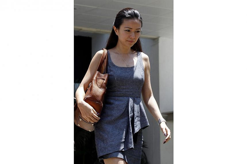 Ms Serina Wee, former finance manager of City Harvest Church (CHC), returns to court on Aug 27, 2013, with a simple yet polished look in her grey dress with a scoop neckline. -- ST PHOTO:WONG KWAI CHOW