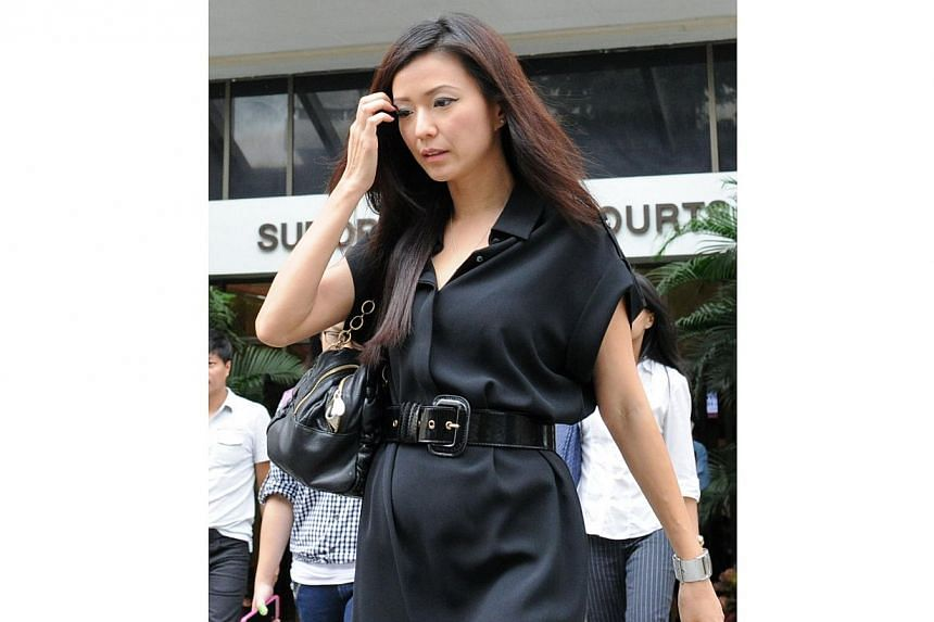 Ms Serina Wee, former finance manager of City Harvest Church (CHC), returns to court on Aug 26, 2013,in a simple black dress with a thick belt. -- ST PHOTO: MUGILAN RAJASEGERAN