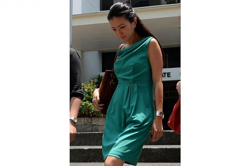 Ms Serina Wee, former finance manager of City Harvest Church (CHC) at court on Aug 28, 2013.-- PHOTO: AFP