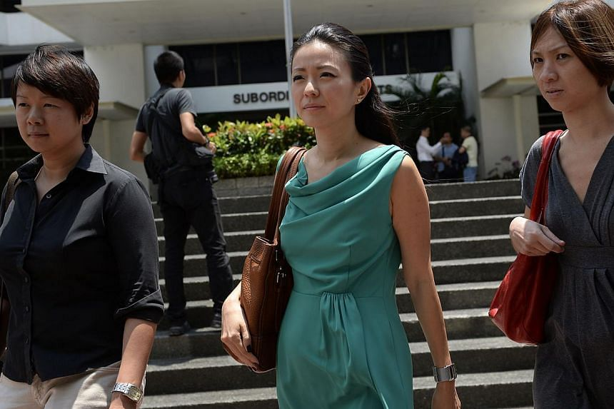Ms Serina Wee, former finance manager of City Harvest Church (CHC) at court on Aug 28, 2013. -- ST PHOTO:DESMOND LIM