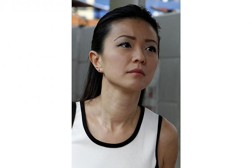 Ms Serina Wee, former finance manager of City Harvest Church (CHC), goes to court in a more casual look on Aug 30, 2013. -- ST PHOTO:WONG KWAI CHOW