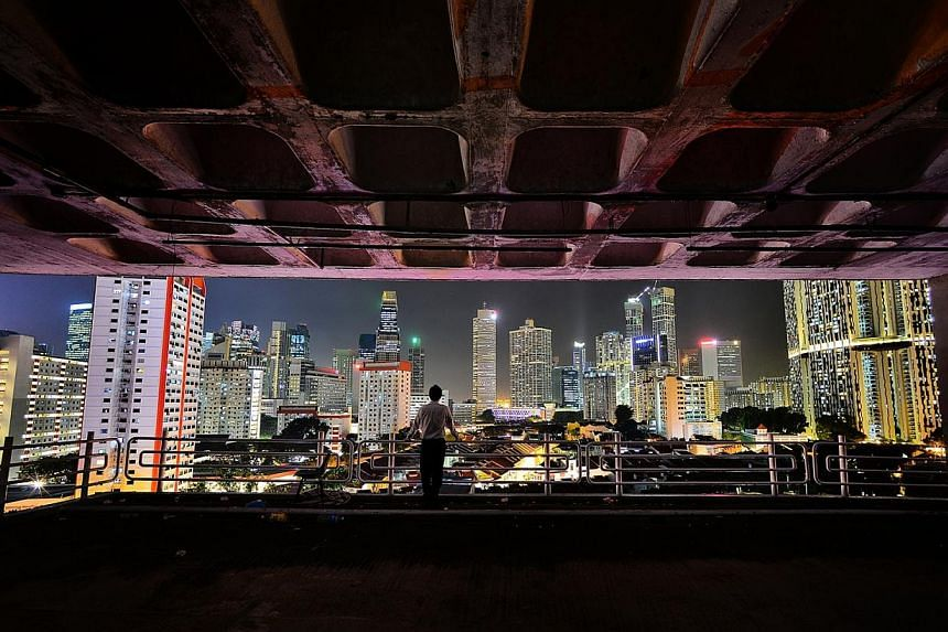 A stunning photo (above) of the glittering Singapore skyline has outshone thousands of other entries to emerge as the top prize of The Straits Times' Wherever You Are photo contest. -- PHOTO: TUNG HON KENG