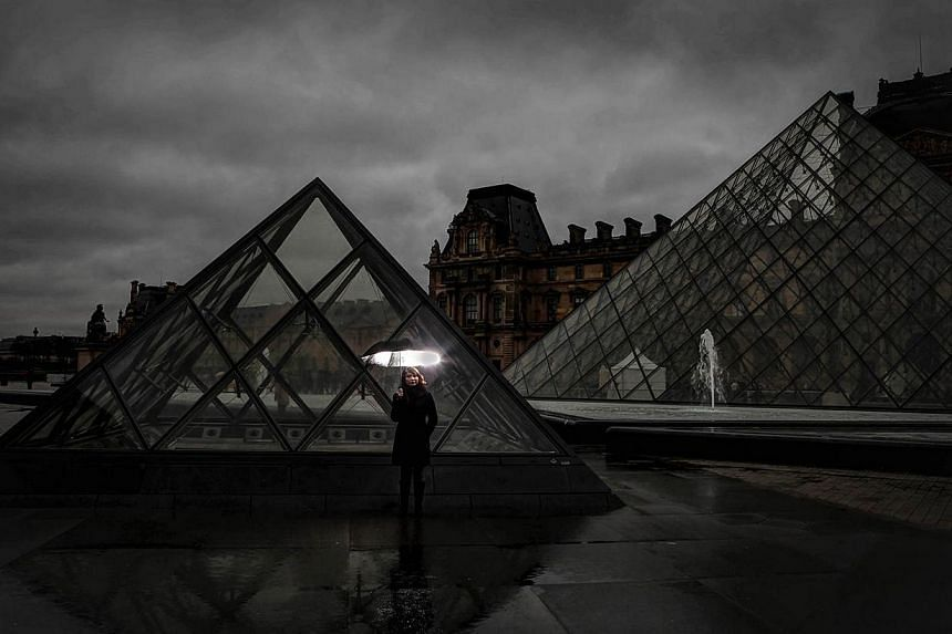 Mr Sean Ng and his wife Cassie walked 30 minutes to the Louvre in Paris, France to snap this shot during their honeymoon. This photo was one of the merit winners in The Straits Times' Wherever You Are photo contest -- PHOTO: SEAN NG