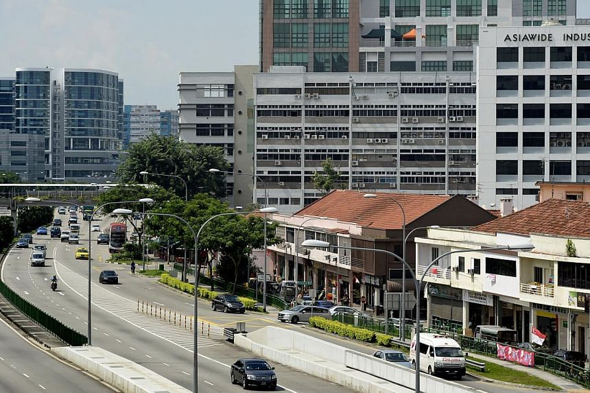 Along Upper Paya Lebar Road, spanking new industrial complexes on one side of the road (left) share the skyline with old industrial buildings and shophouses on the other side.  Mr Allen Goh, 36, restoring antiques outside his family's antiques shop i