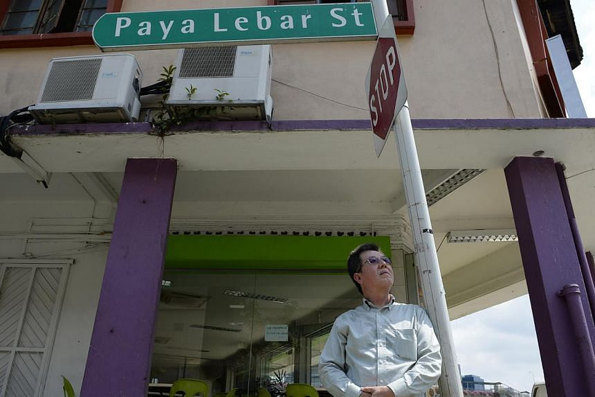 Mr David Sia (above) standing in front of a shophouse which used to be the factory where his mother worked when the family lived in the Tai Seng area. -- PHOTO: DESMOND LIM