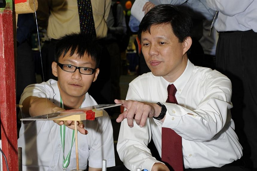 Acting Minister for Social and Family Development and Senior Minister of State for DefenceChan Chun Sing (right) with River Valley High School student Koh Hong Kai, 16. Hong Kai's team won 2nd place in Category C (Sec 4-JC1) ofthe fourth