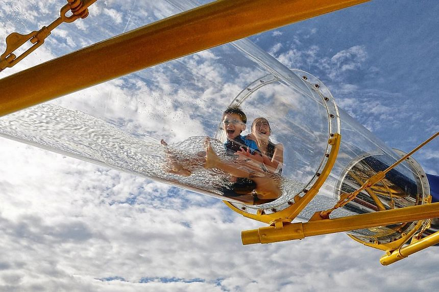 Mr Robin Tan's winning photo of his son Chang Chuen and daughter Ee Shuen enjoying themselves on a water slide aboard the SuperStar Virgo cruise ship during a family holiday. This photo won second prize in The Straits Times' Wherever You Are photo