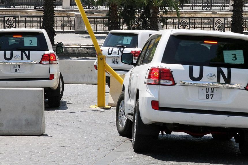 Vehicles of the United Nations (UN) inspectors leaving a hotel for another probe of Syria chemical attack on their last day of inspections, near the Syrian capital Damascus on Friday, Aug 30, 2013. Syria will reject any partial UN conclusions on an a