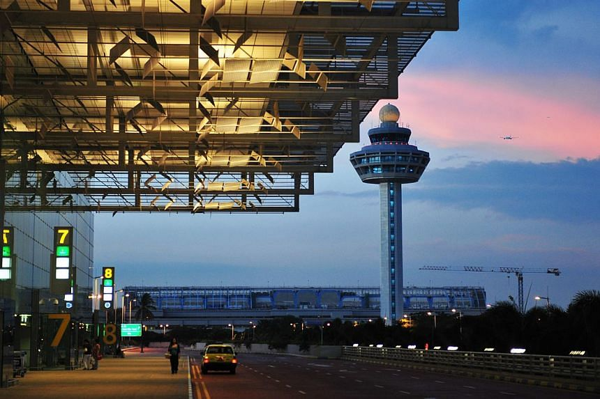 The arrival porch at Changi Airport's Terminal 3. A new, mega Terminal 5 will be ready by the middle of next decade at Changi East and have the capacity to handle 50 million passenger movements a year - larger than T2 and T3 combined. -- ST FILE PHOT