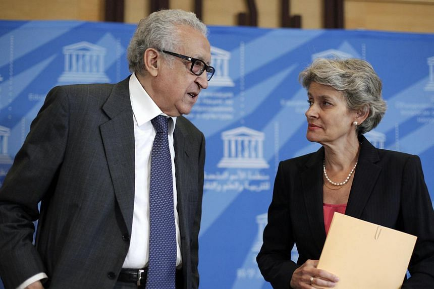 The United Nations' Joint Special Representative for Syria, Mr Lakhdar Brahimi (left), talks with Director-General of Unesco, Ms Irina Bokova, after they gave a press conference on the impact of the civil war on the cultural sites in Syria, at the Un