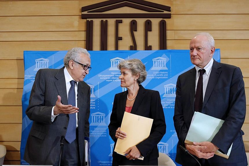 United Nations-Arab League special envoy for Syria, Mr Lakhdar Brahimi (left), speaks with the director general of Unesco, Ms Irina Bokova (centre), and Unesco deputy director Francesco Bandarin, during a press conference at the Unesco, on Aug 29, 20