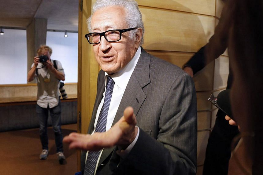 United Nations-Arab League special envoy for Syria, Mr Lakhdar Brahimi, speaks to journalists as he leaves a press conference at the Unesco on Aug 29, 2013, in Paris. Unesco on Thursday urged Syria's regime and rebels to spare multi-millennial herita