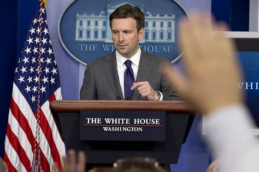 White House deputy press secretary Josh Earnest answers reporters' questions in the briefing room of the White House in Washington on Aug 29, 2013, where he talked about Syria and the use of chemical weapons as the administration debates what action