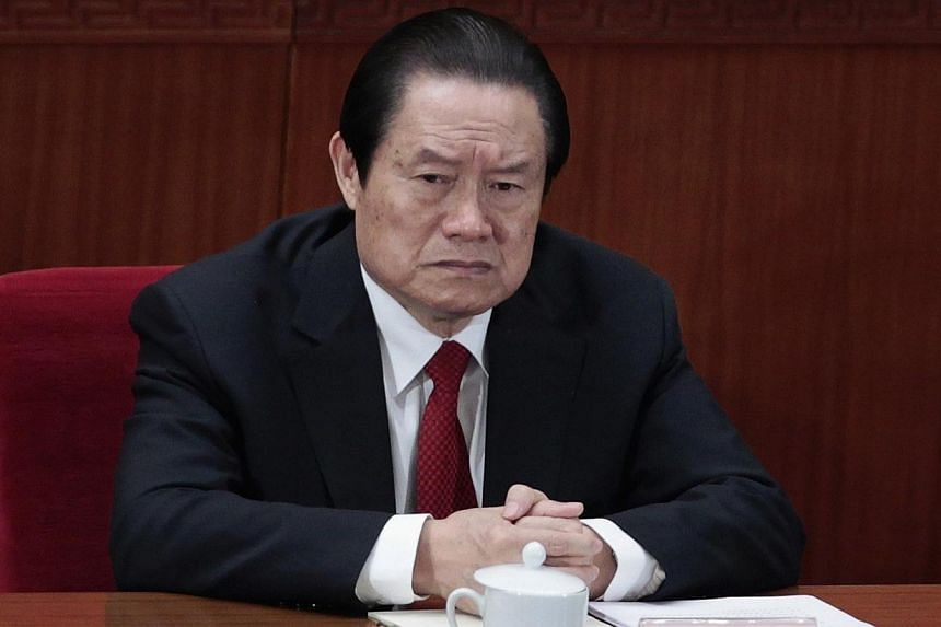 Former China's Politburo Standing Committee Member Zhou Yongkang attends the closing ceremony of the National People's Congress (NPC) at the Great Hall of the People in Beijing on March 14, 2012. China's senior leadership has agreed to open a corrupt