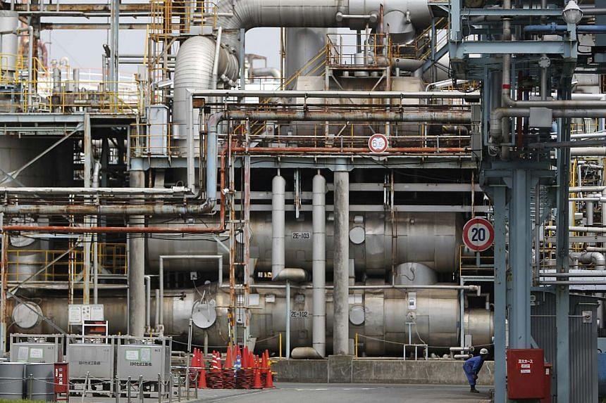 A man works at a factory at Keihin industrial zone in Kawasaki, south of Tokyo, June 28, 2013. -- FILE PHOTO: REUTERS