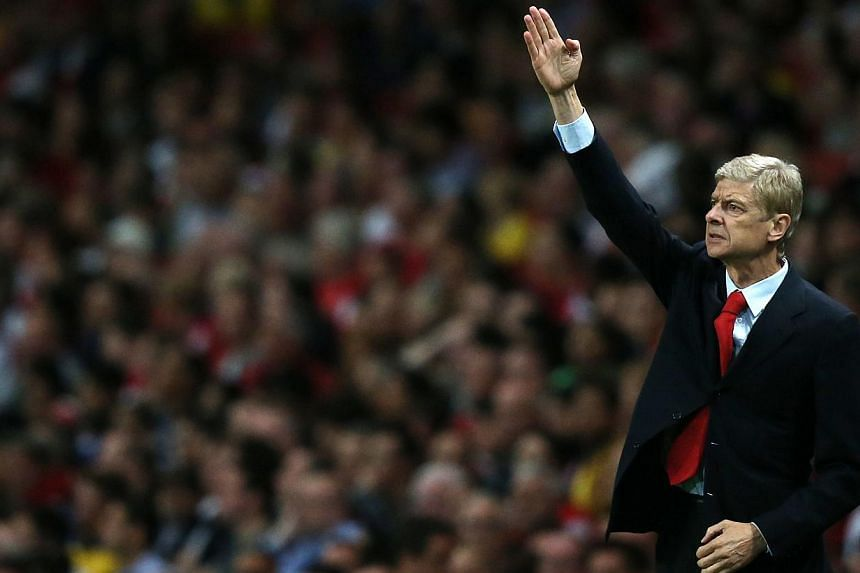Arsenal's French manager Arsene Wenger gestures during the Uefa Champions League Play-Off second leg football match at The Emirates Stadium in north London on Aug 27, 2013. Wenger lit the fuse on Sunday's explosive north London derby as the Arsenal m