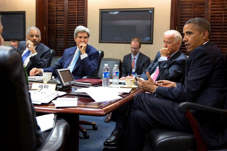 In this image provided by The White House, President Barack Obama meets with his national security staff to discuss the situation in Syria, in the Situation Room of the White House, on Friday, Aug 30, 2013, in Washington, including from left national