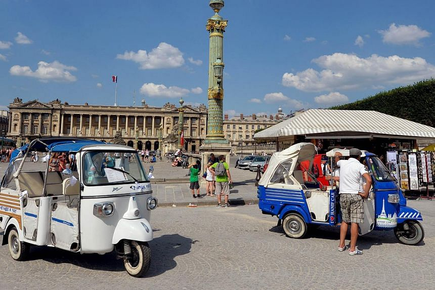 A picture taken on July 19, 2013 in Paris shows several tuk-tuks (auto rickshaw) parking near the Jardin des Tuileries. The humble tuk-tuk, a fixture in Asian cities from Bangkok to Bangalore, is rapidly becoming a common sight in the touristy parts