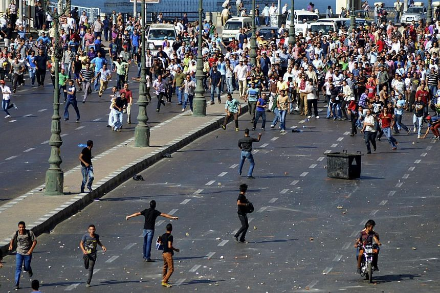 Supporters and opponents of Egypt's ousted president Mohamed Mursi clash in Alexandria, Egypt on Friday, Aug 30, 2013.Five civilians died in clashes in Egypt on Friday when opponents and supporters of Mr Mursi clashed in several cities, the Hea