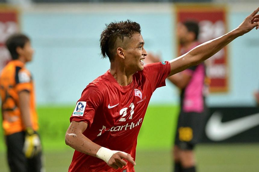 LionsXII centre-backSafuwan Baharudin celebrates his goal against Perak at the Jalan Besar Stadium on Saturday, Aug 31, 2013.The LionsXII gave their flagging Malaysia Cup campaign a much-needed shot in the arm with a 2-1 win over Perak on