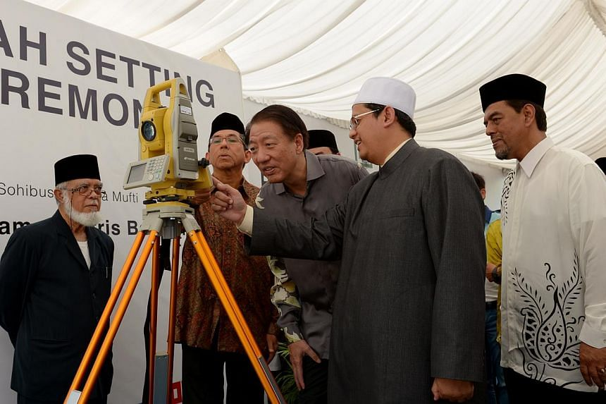 Minister-in-charge of Muslim AffairsYaacob Ibrahim (centre, left) and Deputy Prime Minister Teo Chee Hean (centre) join Singapore's Mufti Mohamed Fatris Bakaram (centre, right)at the groundbreaking ceremony for the new Al-Islah mosque in