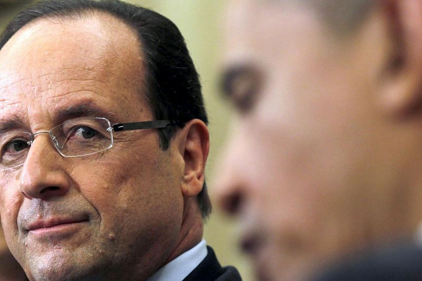 French President Francois Hollande (left) meets with United States President Barack Obama in the Oval Office of the White House in Washington on May 18, 2012. Most French people do not want France to take part in military action on Syria an