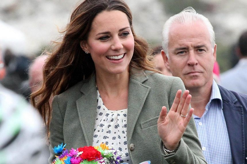 Kate, Duchess of Cambridge waves as she visits Breakwater country park at an event to start the Ring O' Fire Anglesey Coastal Ultra Marathon in Holyhead on Anglesey, north Wales, on Aug 30, 2013. -- PHOTO: AFP