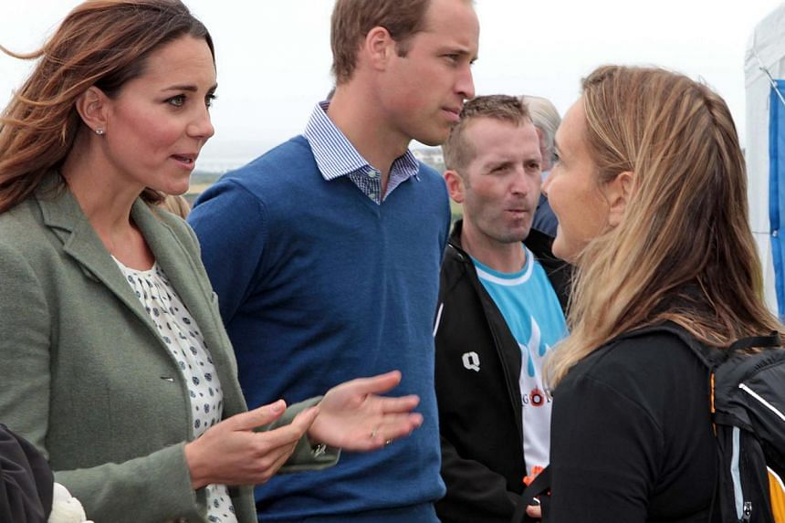 Britain's Prince William, Duke of Cambridge (second left), and Kate, Duchess of Cambridge (left) talk with TV presenter and ultra endurance marathon runner Lowri Morgan (right) at Breakwater country park at an event to start the Ring O' Fire Angles