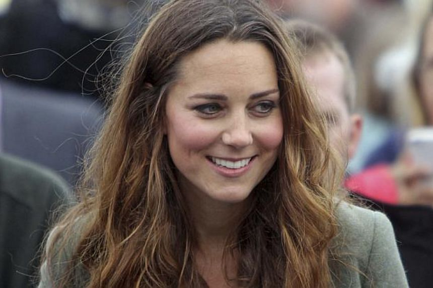 Britain's Kate, Duchess of Cambridge visits the Breakwater country park, to start the Ring O Fire ultra marathon, in Anglesey, north Wales Aug 30, 2013. -- PHOTO: REUTERS
