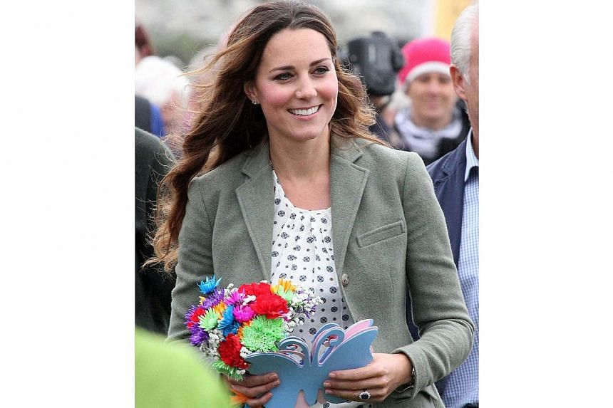 Britain's Kate, Duchess of Cambridge, visits Breakwater country park at an event to start the Ring O' Fire Anglesey Coastal Ultra Marathon in Holyhead on Anglesey, north Wales, on Aug 30, 2013. Kate attended her first public event since giving birt
