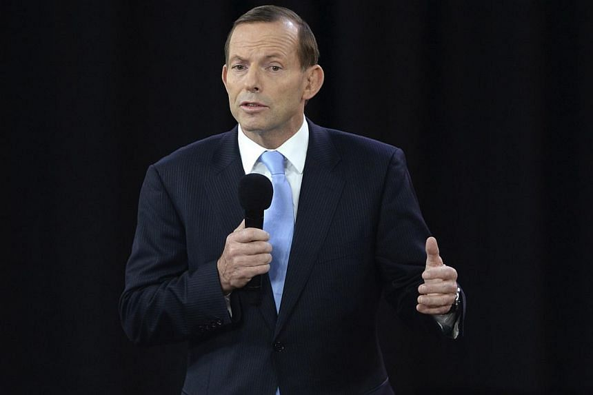 Opposition leader Tony Abbott talks during the People's Forum with Australian Prime Minister Kevin Rudd in Sydney on Aug 28, 2013. The conservative frontrunner to become Australia's next prime minister came under fire on Sunday after describing the c