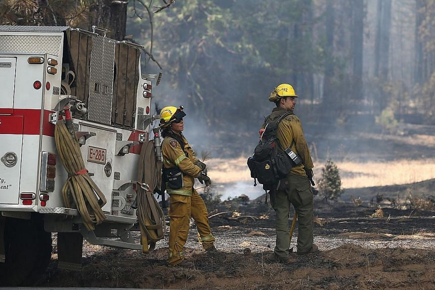 El Dorado Hills firefighters takes a break from battling the Rim Fire on Aug 28, 2013 near Groveland, California. Over 3,500 firefighters are battling the destructive Rim Fire that has charred 180,000 acres and has entered a section of Yosemite Natio